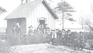 A family standing in front of a Genesee County schoolhouse more than 100 years ago. Photo provided