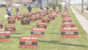 Volunteers put 395 signs bearing the names of graduating Davison High School seniors in an open lot along M-15 as a salute to the Class of 2020.