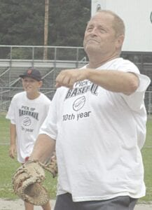 Dale Harris pitching to a youngster back in 2013 Photos provided