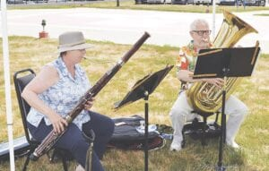 Pictured here is tuba player Joe DeMarsh and bassoonist Nora Shankin, who played a 20-minute session on the lawn of McLaren's outside courtyard as medical staff took a break at lunchtime. A violin duo and a clarinet duo followed later in the afternoon. Photo by Ben Gagnon