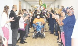 "Terrell Harris received a ""clap out"" from staff at McLaren Flint, July 9, after spending nearly 15 weeks in the hospital recovering from COVID-19. Photo provided"