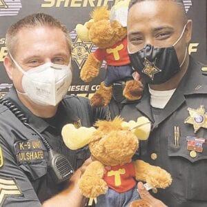 Genesee County Sheriff's deputies display Tommy Moose plush toys, which they will distribute to children they encounter in various traumatic situations. Photo provided