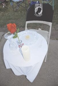 An empty table setting to honor those listed as POW/MIA.