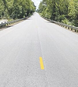 Newly paved Seymour Road on July 24, with temporary lane stripes.