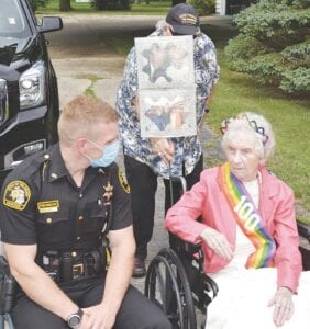 Birthday girl Dorothy Gramer was lavished with love by her family, friends and caretakers—plus some special guests from the Genesee County Sheriff's Department. Photo by Ben Gagnon