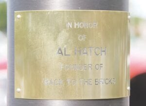 The main flagpole was dedicated to Back to the Bricks Founder Al Hatch.