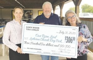 From left: Attorney Dawn Weier, former Burton City Councilman Steve Hatfield and current Councilwoman Tina Conley showing a check presented at the recent Dog Park Spaghetti Dinner fundraiser. Weier and Conley donated gifts to raffle off for the Dog Park and raised more than $300 for this charity. Steve Hatfield, Kris Johns and Our Risen Lord Lutheran Church have been working on bringing the dog park to Burton. Photo provided