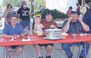 Judges of the contest, from left: Davison Township Supervisor Tim Elkins; Davison City Councilman Ben Callis (with daughter Aubrey); and Davison Police Chief Don Harris.