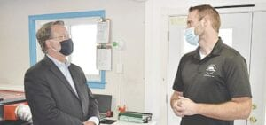 Brian Bowden (right) gives Sen. Gary Peters (left) a tour of BAJ Glass. Photo by Ben Gagnon