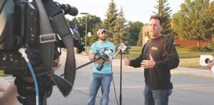 Genesee County Sheriff Chris Swanson gives a press briefing to media on Aug. 14 in the parking lot of the Lake Fenton High School on GHOST operations. Photo by Hannah Ball