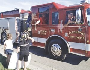 Kolby Adams, 7, was surprised to find out that all that commotion in his neighborhood was for him. On Tuesday, Aug. 11, more than 70 fire trucks, ambulances and police vehicles combined to form a two-mile long parade to honor the Swartz Creek youngster who has won their hearts. Kolby is known to many for his vlog, Michigan Fireside Cinema, on YouTube. Kolby, with help from his parents, Don and Jamie Adams, chases fires, film and photograph the goings-on on scene, and post them online to show what firefighters do for their communities. The procession also included a fly-over by a medical helicopter. Kolby said he was surprised, and his favorite part was that his girlfriend was there.