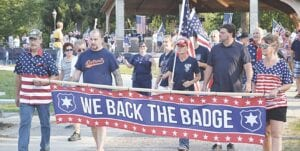 The We Back the Badge march began at Riverview Park and proceeded through downtown Flushing. Photos by Ben Gagnon