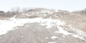 The dirt mound (shown last winter) located off Gale Road next to the Davison Dog Park is what was excavated from the site of Lake Callis when it was built six years ago. File photo