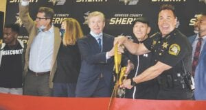 Genesee County Sheriff Chris Swanson (right), along with retired Genesee County sheriffs Robert Pickell (left) and Joe Wilson (middle) performed the ribbon-cutting honors for the IGNITE program. Photos by Ben Gagnon