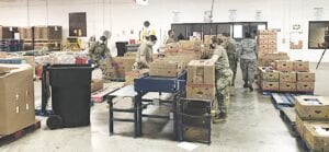 Michigan National Guard personnel hard at work in the warehouse at the Food Bank of Eastern Michigan. Photo provided
