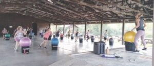 Students get a full-body workout in the cardio drumming class through the Grand Blanc Township Parks and Recreation program at Bicentennial Park. Photo by Lania Rocha