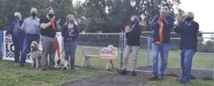 Representatives from Friends of the Burton Dog Park and Our Risen Lord Lutheran Church, and local elected officials, cut the ribbon to officially open the Burton Dog Park at the church. Photos by Lania Rocha