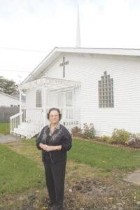 Head Minister/Pastor Rev. Jean Bilbrey Genaw outside the First Metaphysical Church, 8267 E. Atherton Rd. in Davison Township. Photo by Gary Gould
