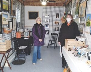 Grand Blanc Arts Council President Shirley Eason and Treasurer Angela Hamilton welcomed guests to the council's pop-up gallery re-opening Sunday at the Grand Chalet Shoppes in downtown Grand Blanc. The gallery will continue at that location until December. Photo by Lania Rocha