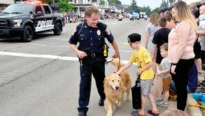 Sgt. Jim Hough and his K-9 Colt interacting with spectators at a Flushing parade. File photo