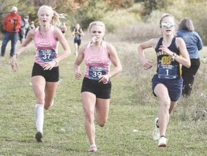 Goodrich freshman Olivia Giza sprints to the finish line at the Saturday pre-regional overtaking her two Linden arch-rivals. Photo provided