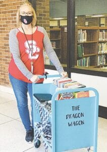 Swartz Creek Middle School Media Specialist Jessica Jewell created the Dragon Wagon to get books to the students. the library all year. Our face-to-face kids can't get books. So, I thought I'd bring the books to Courtesy photos