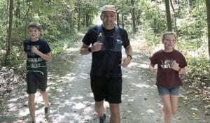 Ryan Litwiller, center, with his children Matthew,12, left, and Kaitlynne, 10, right. They ran a portion of the 100-mile race with their father. Photo provided