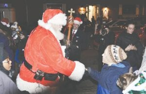 Santa Claus visiting with Flushing residents at last year's Candlewalk. File photo