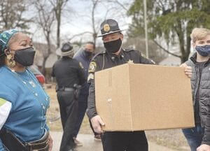 Walk With Us pic 1: Genesee County Sheriff's deputies making a Christmas box delivery Photo provided