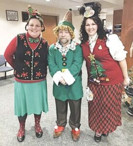 Burton City employees, from left, Katie Malin, Rik Hayman and Clerk Racheal Boggs dressed for Christmas. Photo provided
