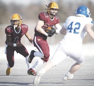 Davison's Carter Cryderman (26), shown here, made a fouryard touchdown against Detroit Catholic Central with 1:58 to go. Davison's Dion Brown, Jr. (1) is also pictured here. Photo by Rusty Bashore