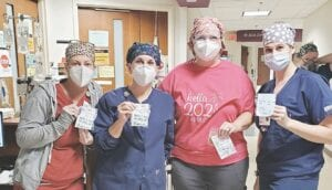 Ascension Genesys hospital staff members Lisa Adas, Jean Nobach, Kristy Clark and Melissa May were pleasantly surprised when they received cookies and inspirational messages. Courtesy photo