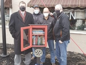 (Left to right): Rotary Club of Flushing members Andrew Schmidt, John Gault, Darwin Scherba and Matt Catlin and installed the Little Free Library in Cornwell Park on Jan. 21. Photo courtesy of the Rotary Club of Flushing