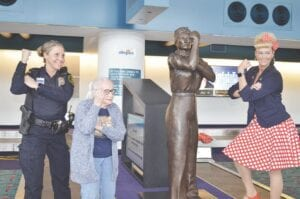 Phyllis Jones (front left) poses with the new Rosie the Riveter statue. To the right is Amber Taylor, who served as the statue's model. Photo by Ben Gagnon