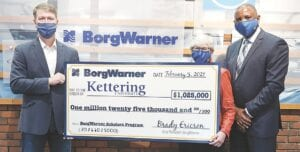 Brady Ericson, President of Morse Systems at BorgWarner, presents a $1,025,000 check to Susan Davies, Vice President of University Advancement and External Relations at Kettering University, and Ricky Brown, Director of Multicultural Student Initiatives at Kettering University, officially establishing the BorgWarner Scholars Program Endowment for the University. Photo provided