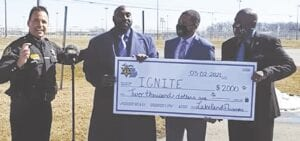 Sheriff Swanson and Genesee County ambassadors received a $2,000 check for the IGNITE program from inmates at the Lakeland Correctional Facility in Coldwater. Screenshot from the Genesee County Sheriff's Office Facebook page