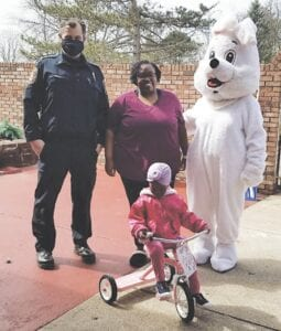 Officer John Chisa with the Flint Township Police Department, along with the Easter Bunny, delivered Bunny Trail grand prizes to multiple families across the township. Photo provided