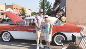 Back to the Bricks Vice Chair Al Jones and his wife, Debbie, pose for a photo in front of their 1956 Buick Special model with a '43 hardtop. Jones is excited to announce the inaugural Dust 'Em Off Car Show, which is scheduled for Sunday, May 23 and will kick off the summer schedule of Back to the Bricks events.