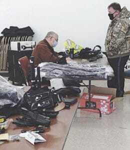 Gaines Township Police Chief Mark Schmitzer records the equipment that the township officers turned in April 1. Voters will decide in May whether to continue to fund the department or continue the process of shutting it down. Photo by Lania Rocha