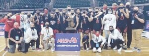 Grand Blanc players and coaches celebrated courtside after winning the school's first-ever Division 1 Varsity Boys Basketball state championship. Photo courtesy of the Grand Blanc High School Athletic Department