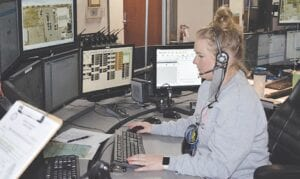 Dispatcher Jessica Young handles emergency calls at the Genesee County 911 call center in Flint Township. Genesee County 911 handles over 400,000 calls annually and typically has 12 to 15 dispatchers on call per shift. Photo by Ben Gagnon