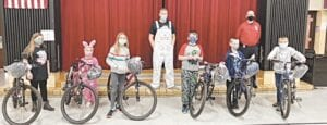 Lucky winners … Students at Elms Road Elementary School who received bikes and helmets were, from left, Emily Conner, Savannah Hindmon, Autumn Sortor, James Ellis, Dante Hatch and Henry Scrivener. They are pictured with Elms Road Principal David Simonsen and school resource Officer Brian Abraham. Courtesy photo