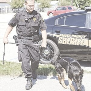 Axel and Lapeer County Sheriff's Office Deputy Frank Ruzicka were in the right place at the right time early Sunday morning to track and help apprehend a Sterling Heights man who stole a vehicle in Davison.