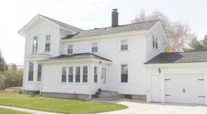 The Applegate farmhouse at 2457 E. Grand Blanc Rd., built in 1872, was recently listed for sale. Photos by Gary Gould