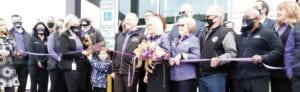 Officials from ELGA Credit Union cut the ceremonial ribbon to officially open the new branch in Grand Blanc Township. Photo by Lania Rocha