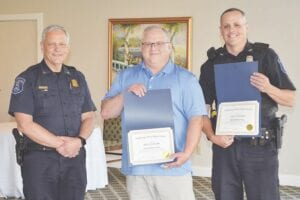 Chief Mark Hoornstra presented unit citations to officers Matthew Jensen (middle) and Michael Good (right). Photo by Ben Gagnon