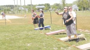 Participants in the Cornhole Tournament in the 2019 Festival of Flags. File photo
