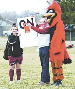 Kelsey Mansell and Davison's Cardinal mascot help Davison super fan Randy Braden flip the ceremonial switch that turned on the soccer field lights for the first time back in 2008. File photo