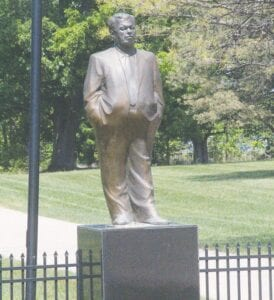 The 8.5-foot bronze statue of former Flint Mayor Don Williamson, who died in 2019, currently sits outside his Davison Township home looking out onto Davison Road. Photo by Gary Gould