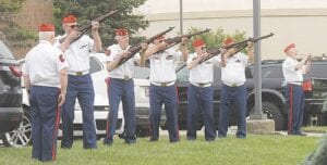 A VFW color guard delivers a 21-gun salute during Burton's Memorial Day ceremony. Photos by Gary Gould